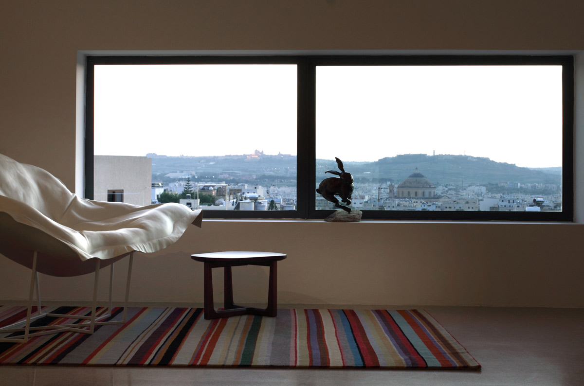 Rug, Large Window, Views, Hanging Home in Naxxar, Malta by Chris Briffa Architects