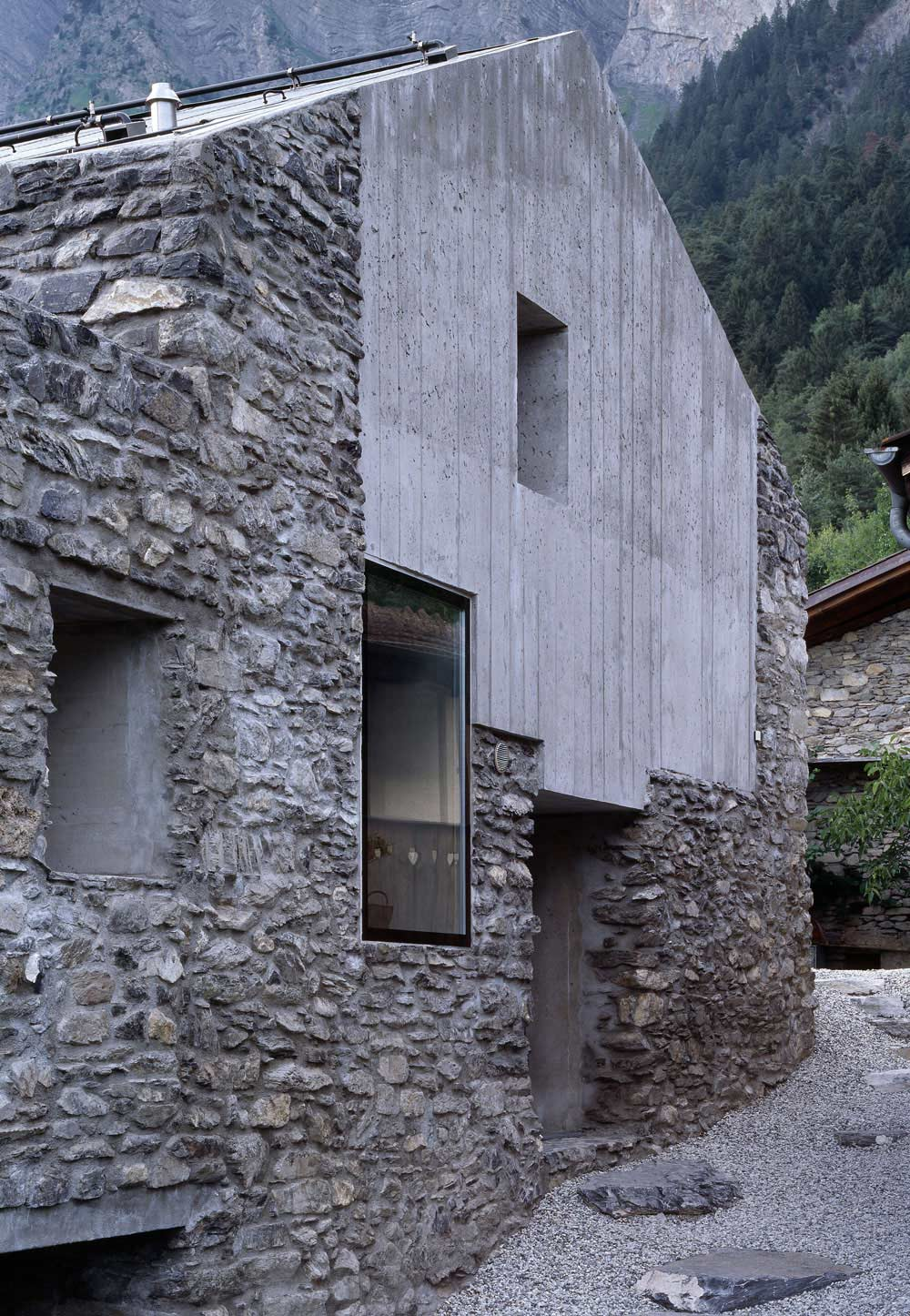 Exposed Concrete, Stone Walls, Renovation in Chamoson, Switzerland by Savioz Fabrizzi Architecte