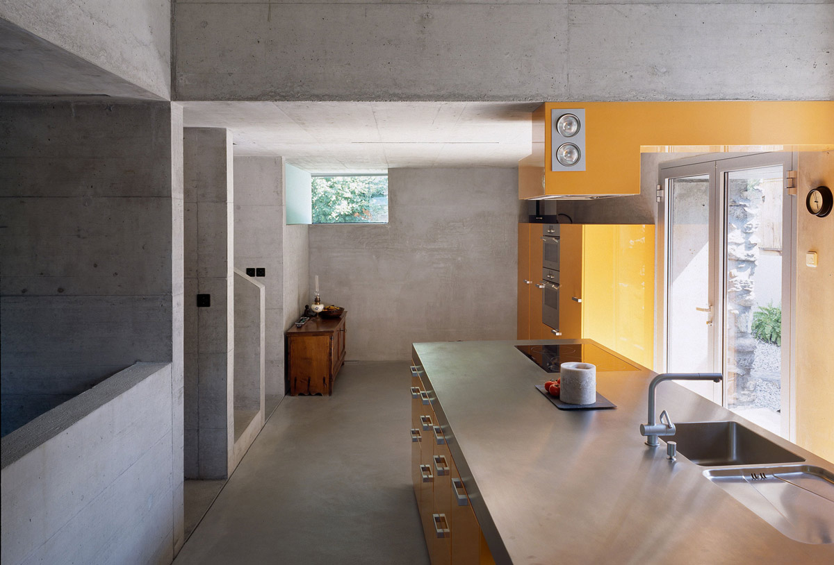 Kitchen, Exposed Concrete, Yellow Units, Renovation in Chamoson, Switzerland by Savioz Fabrizzi Architecte