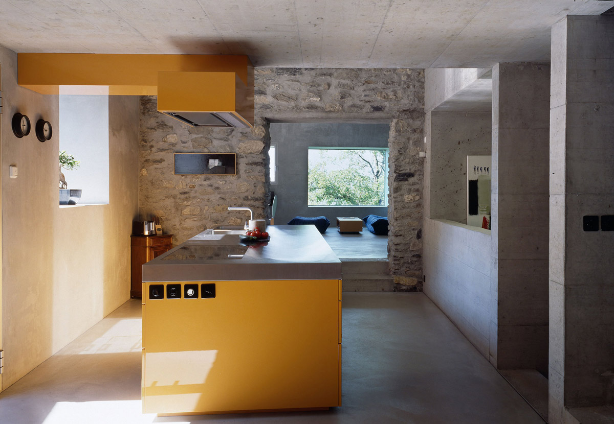 Yellow Kitchen Island, Renovation in Chamoson, Switzerland by Savioz Fabrizzi Architecte