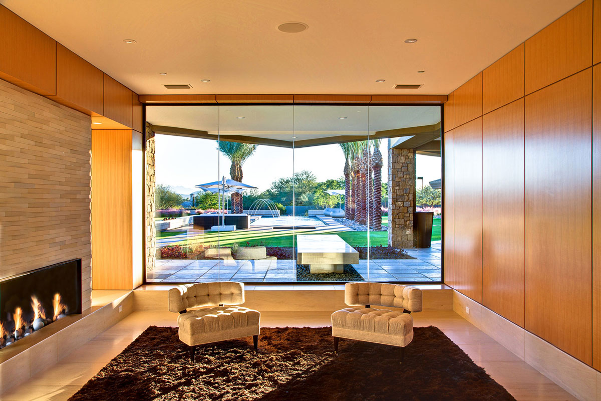 Brown Rug, Fireplace, Glass Walls, Ironwood Estate in Paradise Valley, Arizona by Kendle Design Collaborative