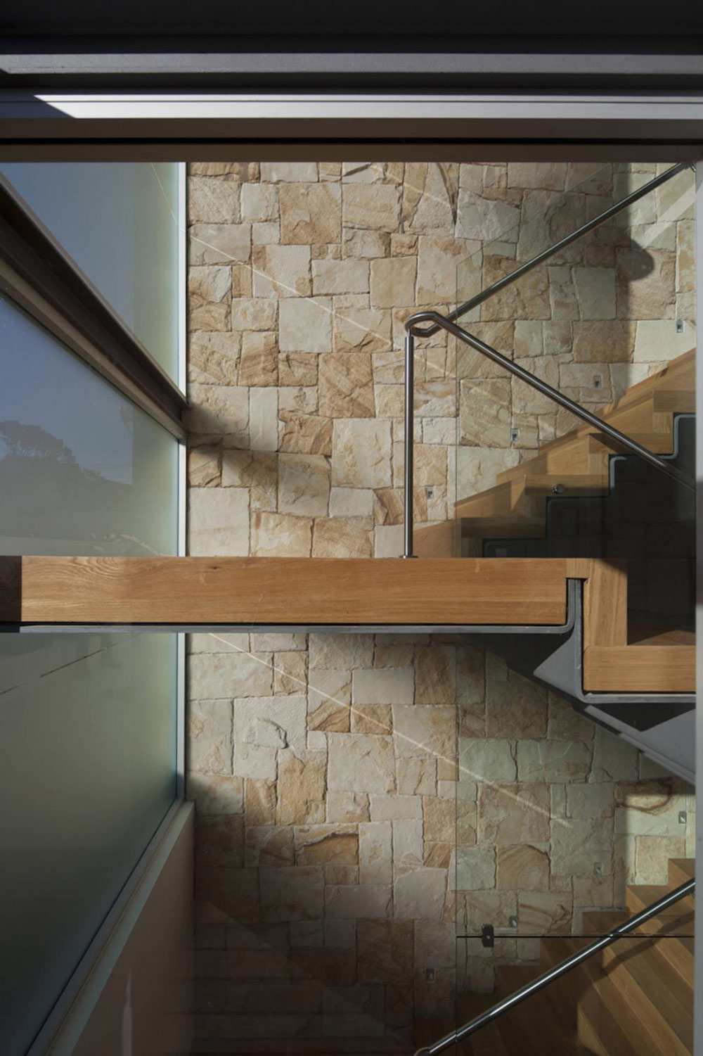 Image gallery modern house stone wall for Modern house stairs