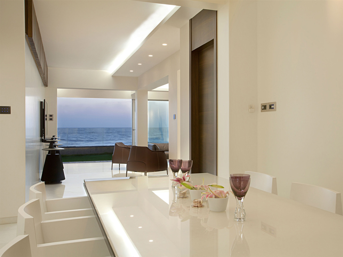 White Dining Table, Apartment by the Beach in Mumbai, India by ZZ Architects