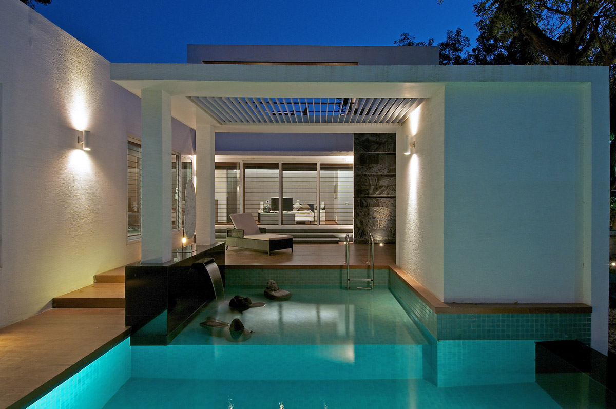 Waterfall, Outdoor Pool, Evening, Dinesh Mill Bungalow in Baroda, India by Atelier dnD