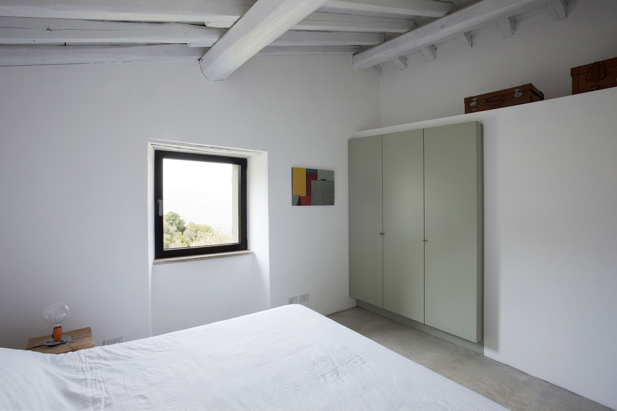 Bedroom, Built-in Wardrobes, Farmhouse in Riomaggiore, Italy by A2BC Architects and SibillAssociati