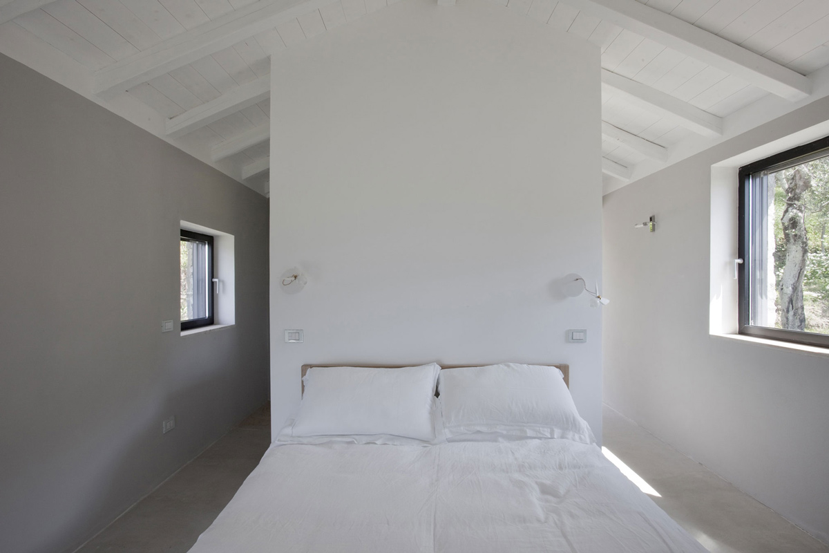 Bedroom, Farmhouse in Riomaggiore, Italy by A2BC Architects and SibillAssociati