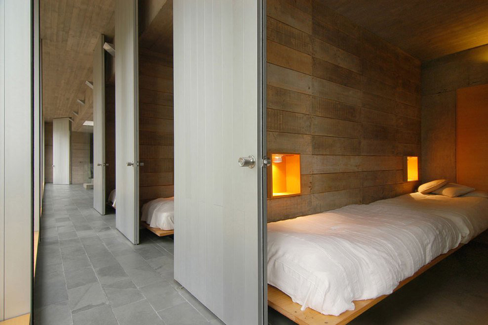 Bedrooms, Lighting, Omnibus House in Cachagua, Chile by Gubbins Arquitectos