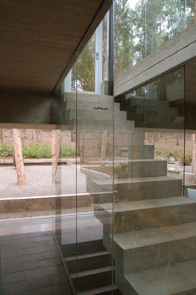 Exposed Concrete, Glass Stairs, Omnibus House in Cachagua, Chile by Gubbins Arquitectos