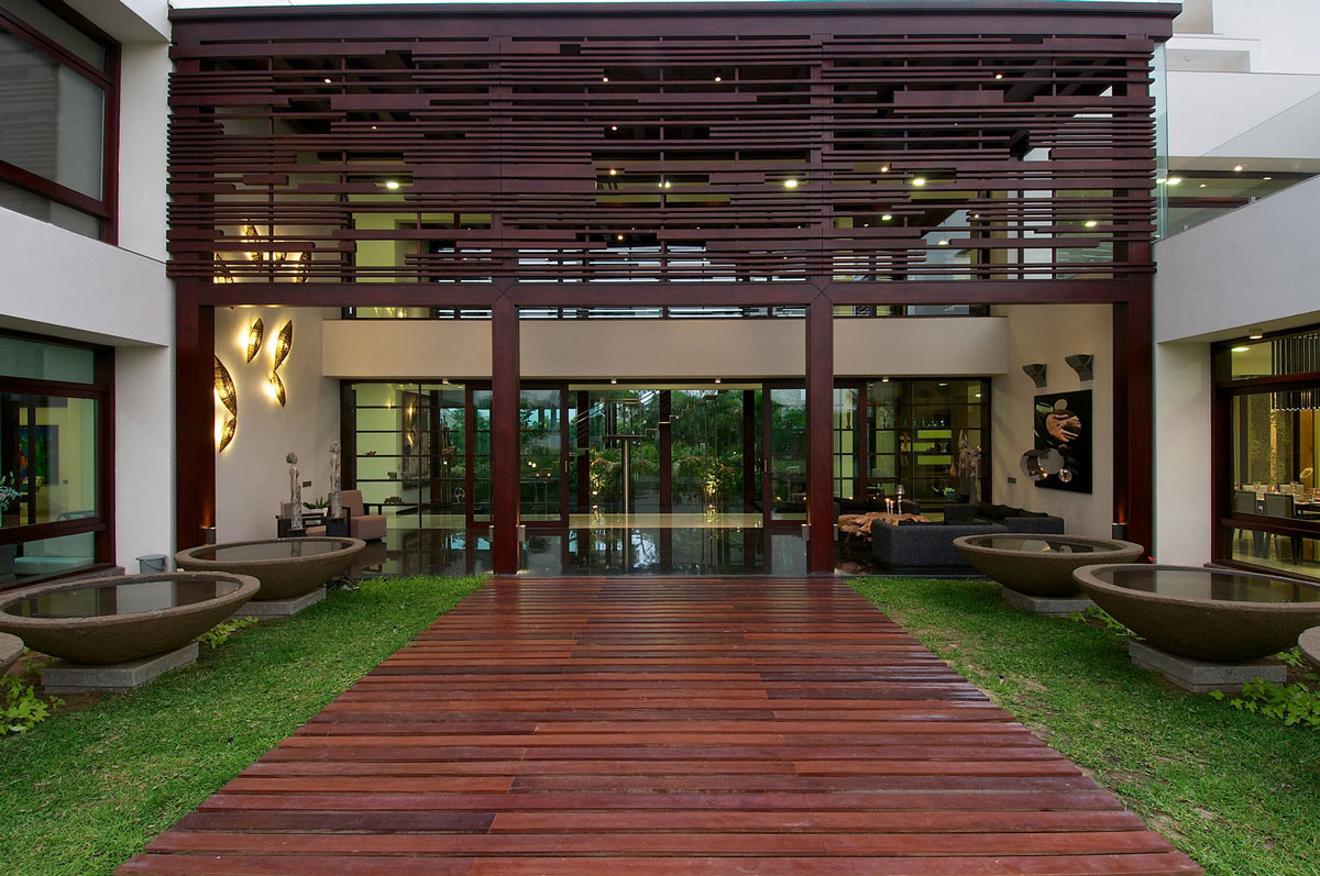 water feature wooden path contemporary house in