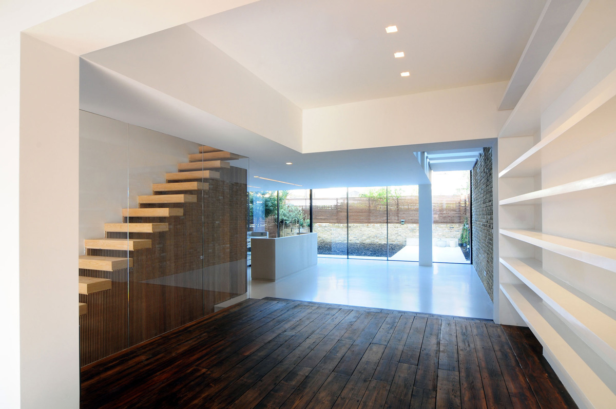 Dark wood flooring stairs glass wall modern home in london by bureau de change design office