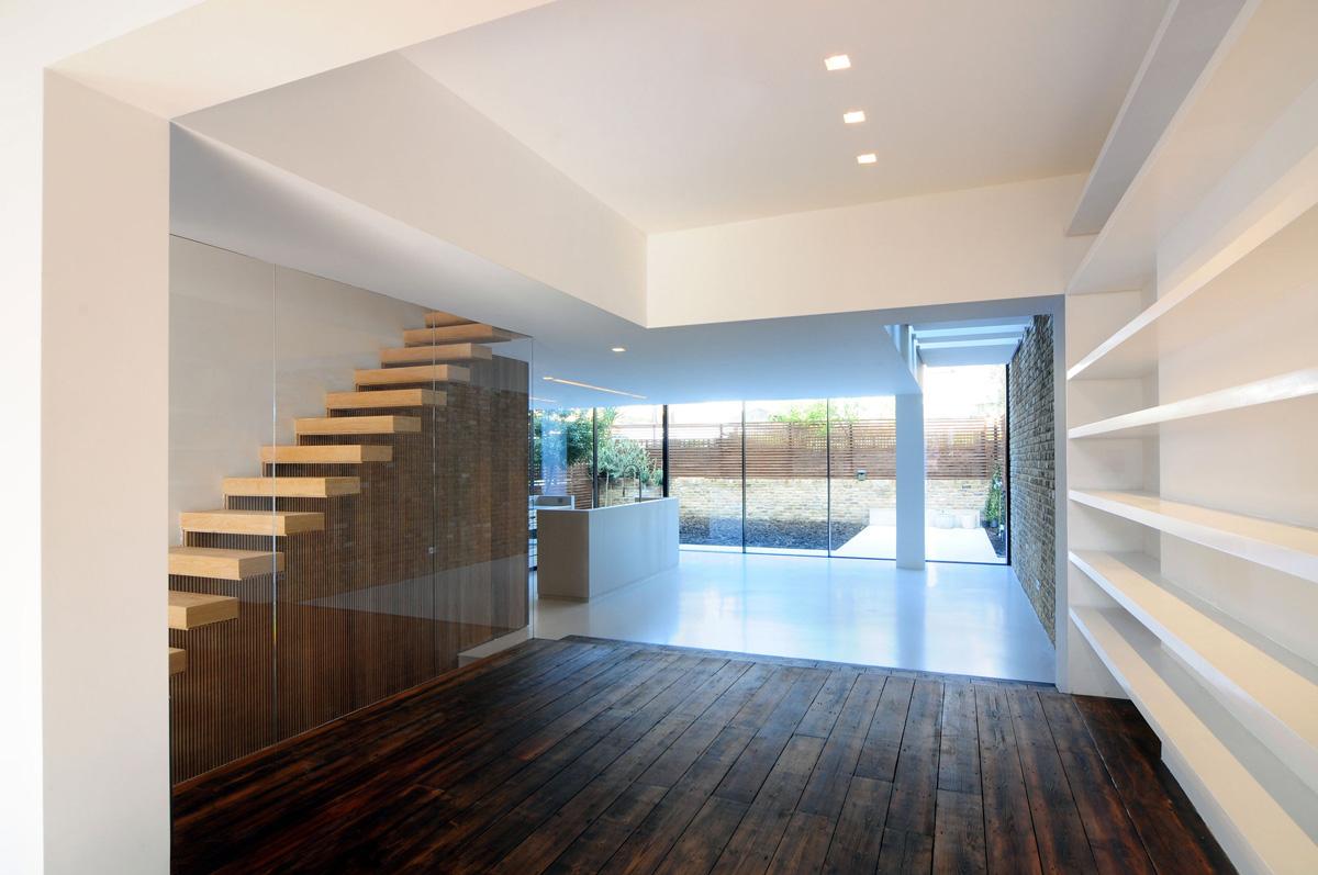 dark wood flooring stairs glass wall modern home in london by bureau de change design office. Black Bedroom Furniture Sets. Home Design Ideas