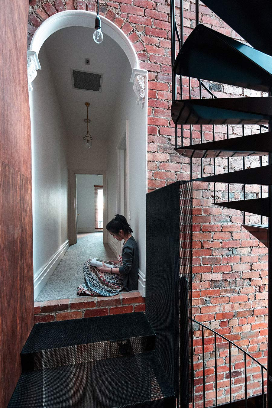 Brick Wall, Stairs, Two-Home Extension Within a Single Building in Richmond, Australia