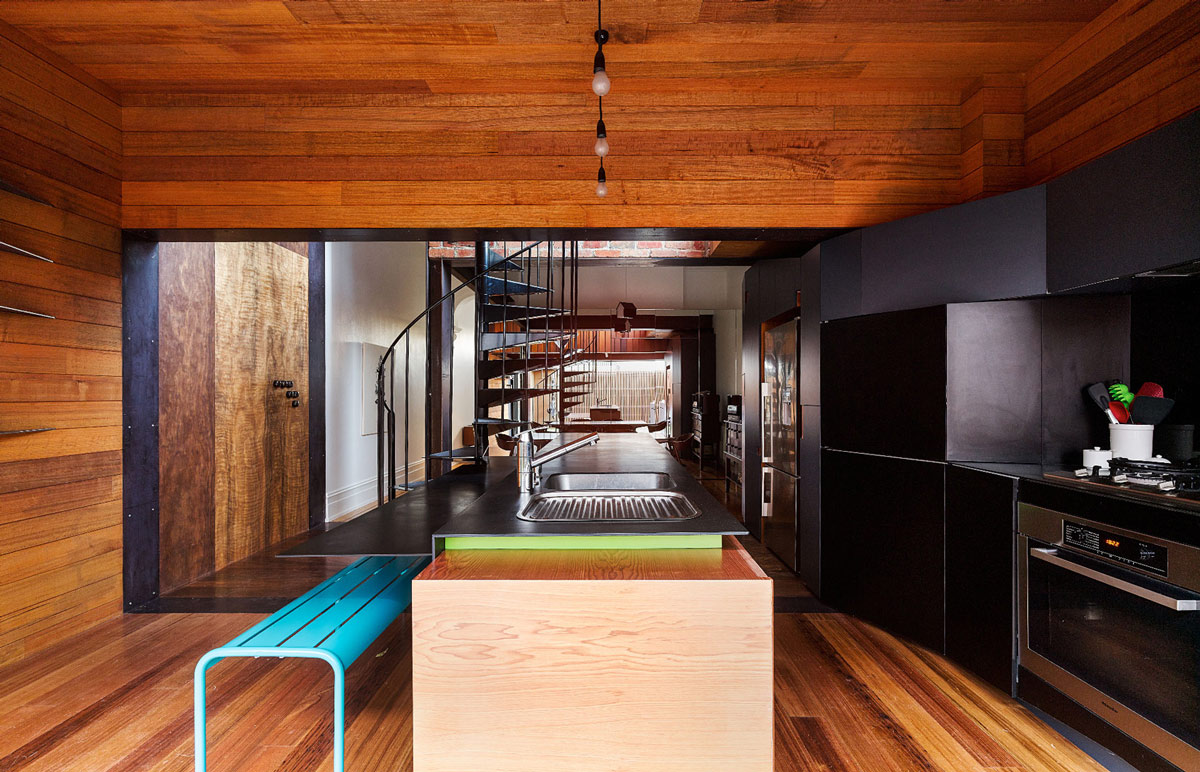 Dark Kitchen, Island, Breakfast Bar, Two-Home Extension Within a Single Building in Richmond, Australia