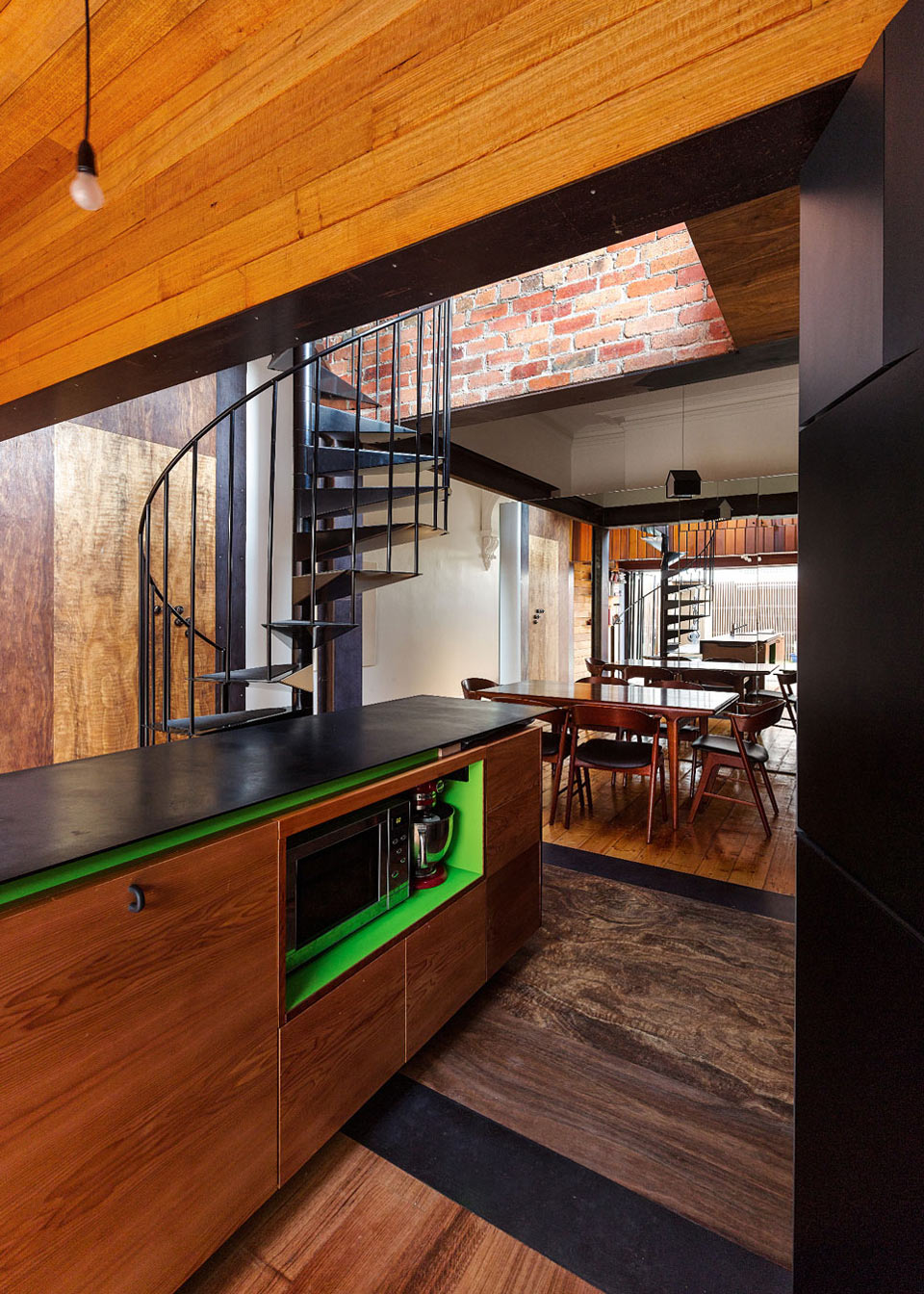 Spiral Stairs, Dining Space, Kitchen Island, Two-Home Extension Within a Single Building in Richmond, Australia