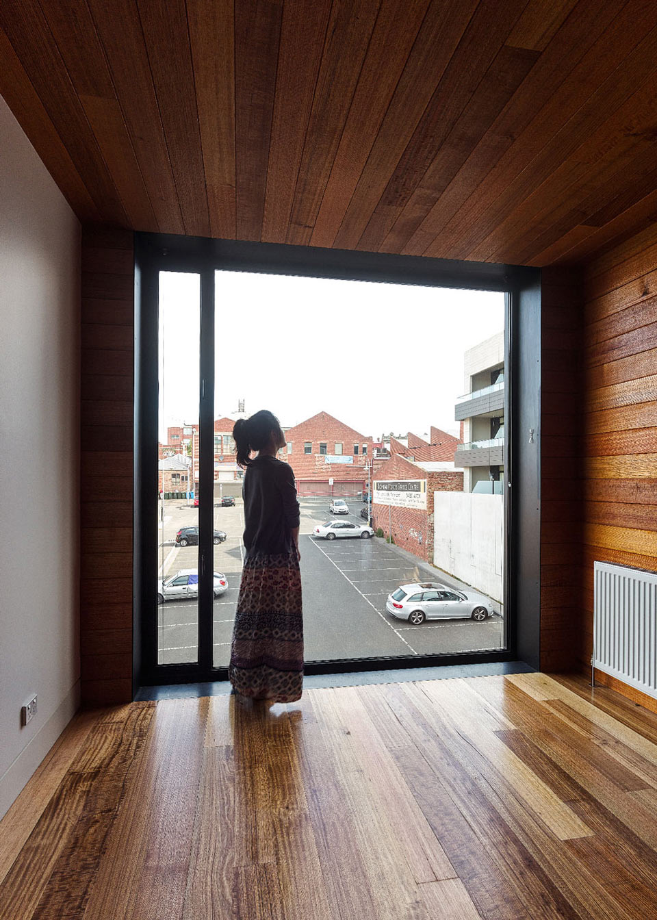 Large Window, Two-Home Extension Within a Single Building in Richmond, Australia