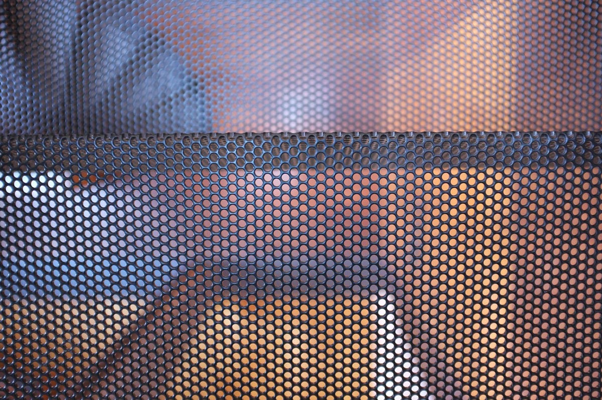 Metal Mesh, Two-Home Extension Within a Single Building in Richmond, Australia