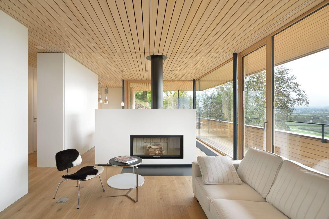 Modern Fireplace, White Sofa, Hillside Home in Weinfelden, Switzerland
