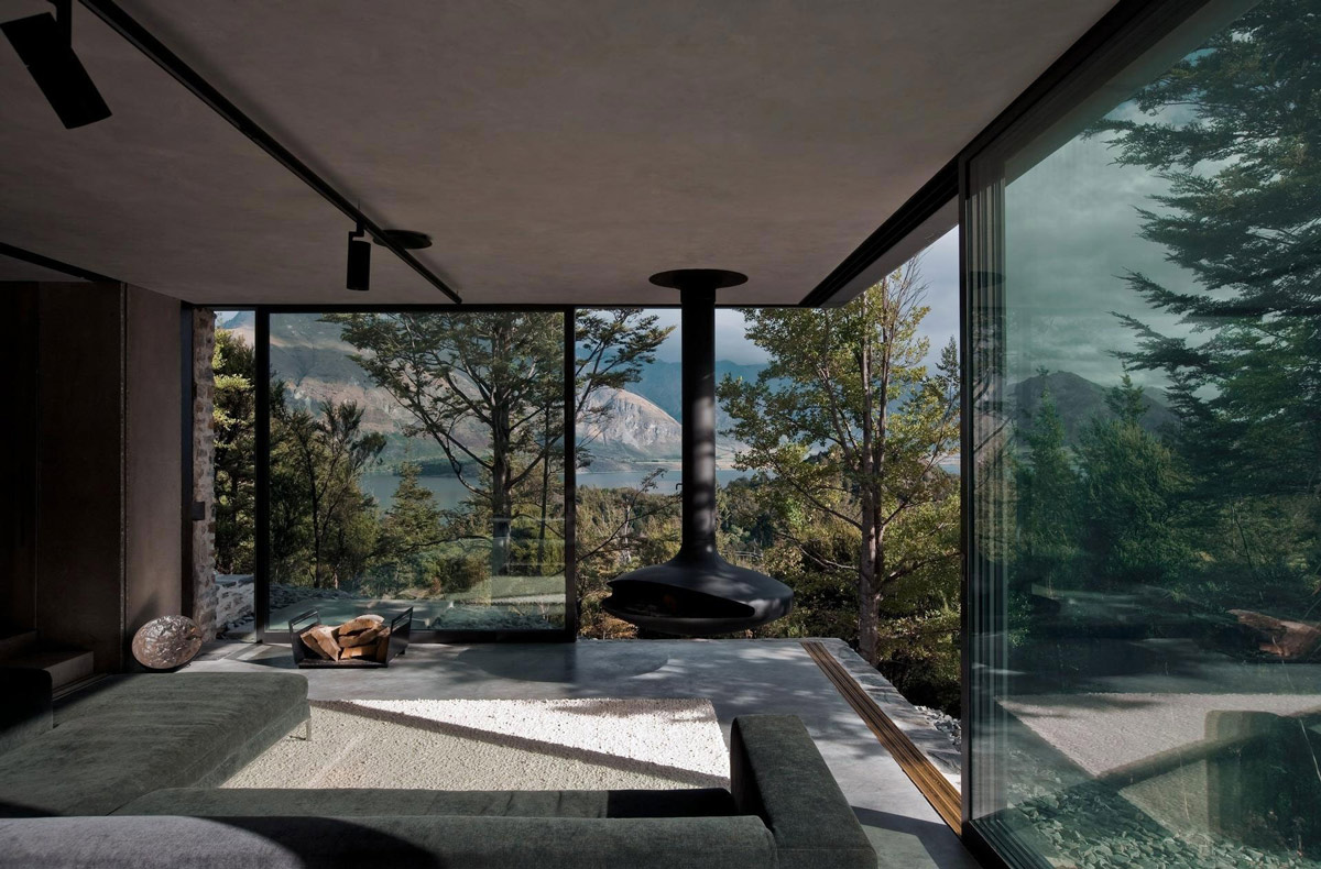 Grey Sofa, Rug, fireplace, Mountain Retreat in Closeburn Station, New Zealand