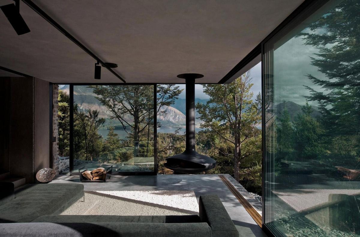 Grey Sofa, Rug, fireplace, Mountain Retreat in Closeburn Station, New Zealand