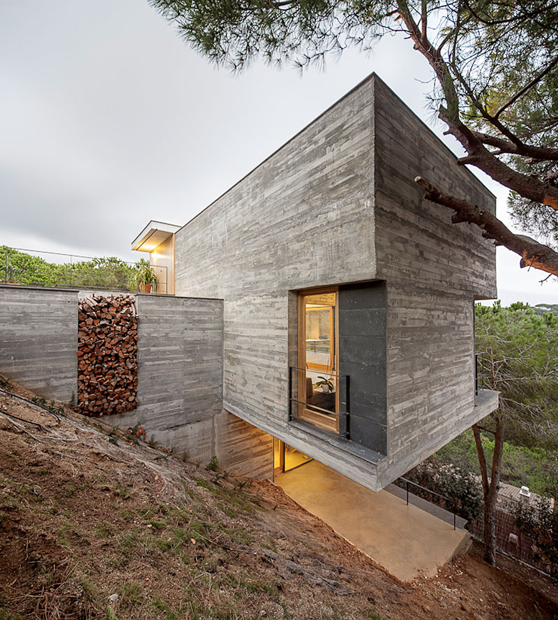 Wood Store, Concrete Home in Sant Pol de Mar, Spain