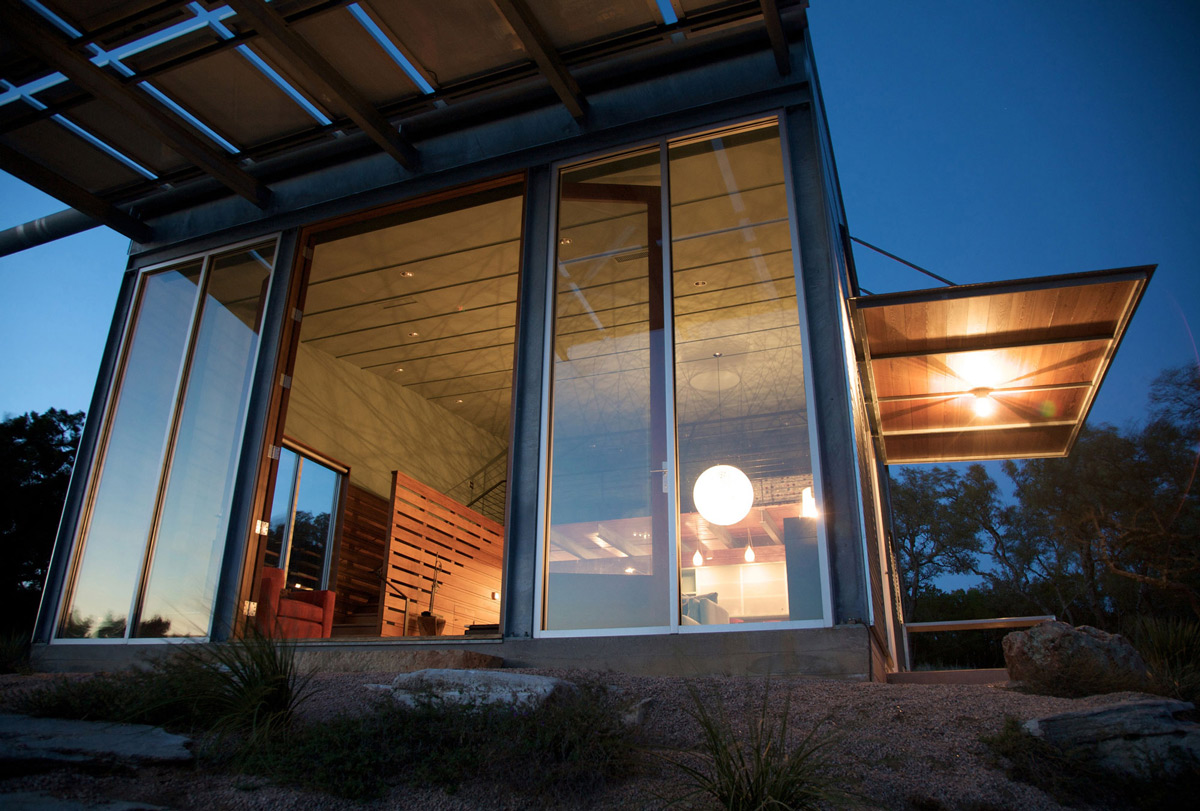 Glass Walls, Patio Doors, Evening Lighting, Simple Eco-Friendly Home Perched Above Lake Buchanan, Texas