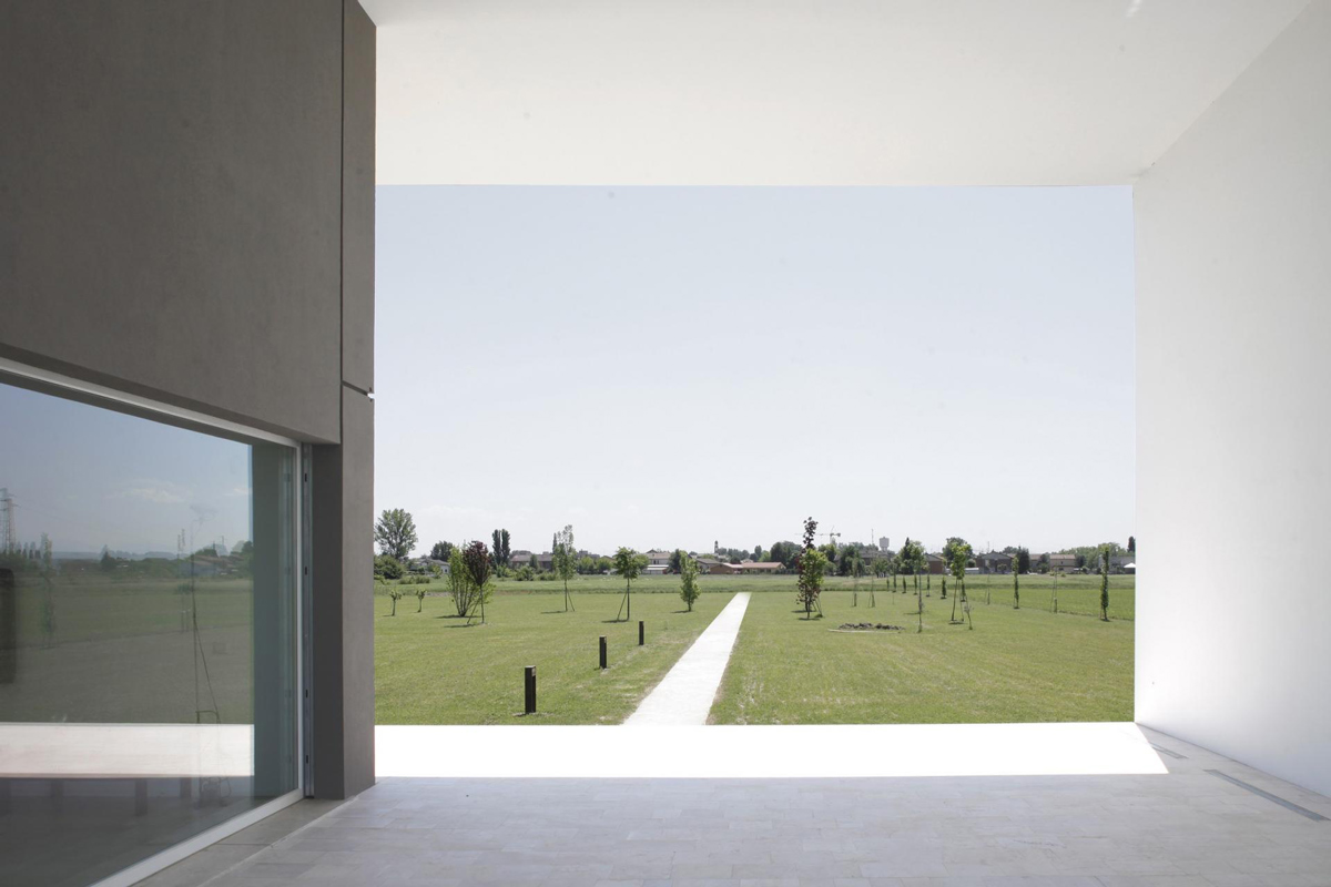 Terrace, Glass Wall, Pathway, Modern Eco-Friendly Home in Castelnovo di Sotto, Italy