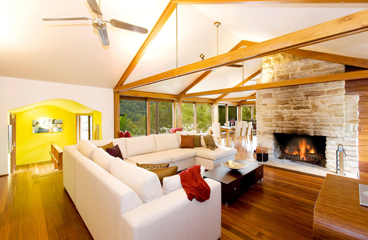 Stone Fireplace, Sofas, Dark Wood Floor, Treetops Holiday Home in Sydney, Australia