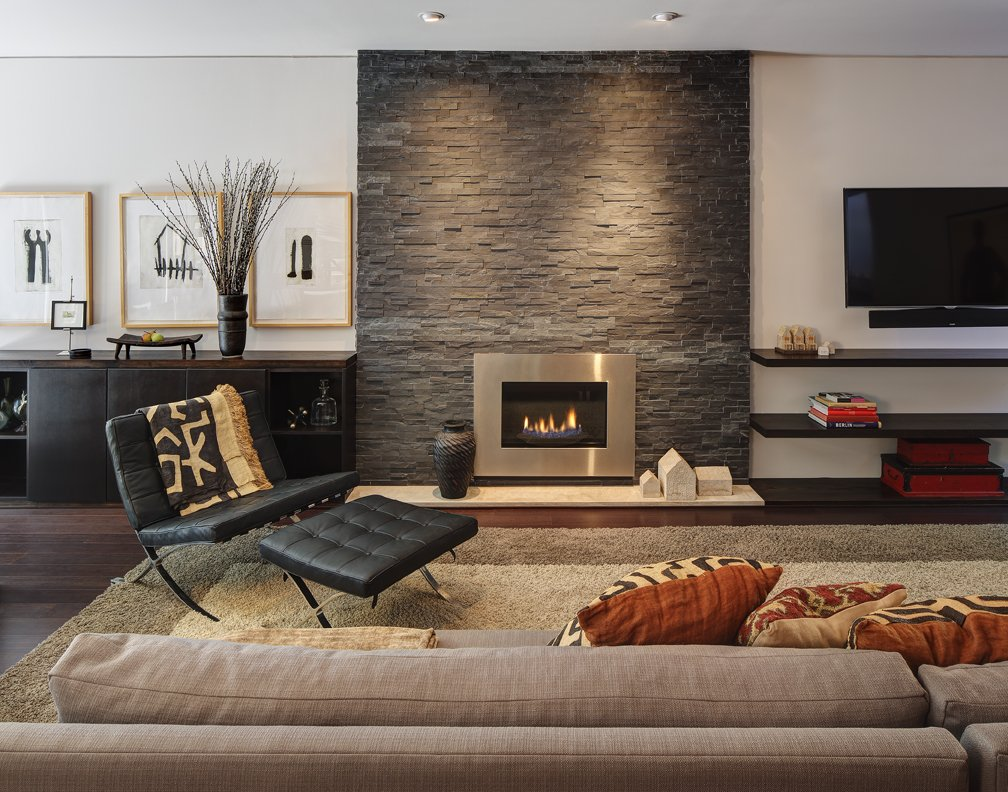 Modern fireplace stone wall chair sofa home renovation in madison wisconsin