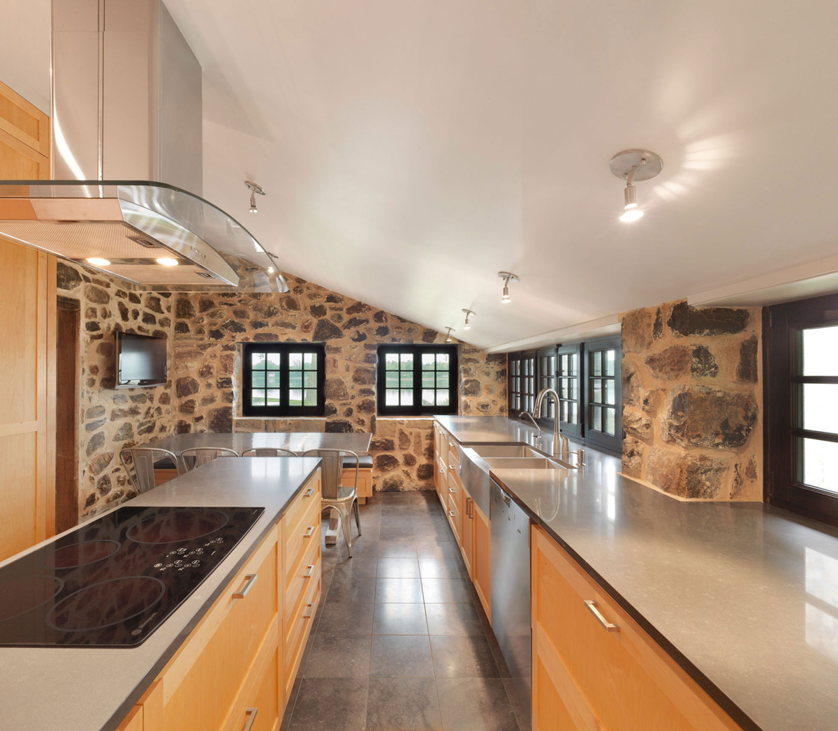 Rustic Modern Kitchen, Stone Walls, Renovation and Addition in Dorval, Canada