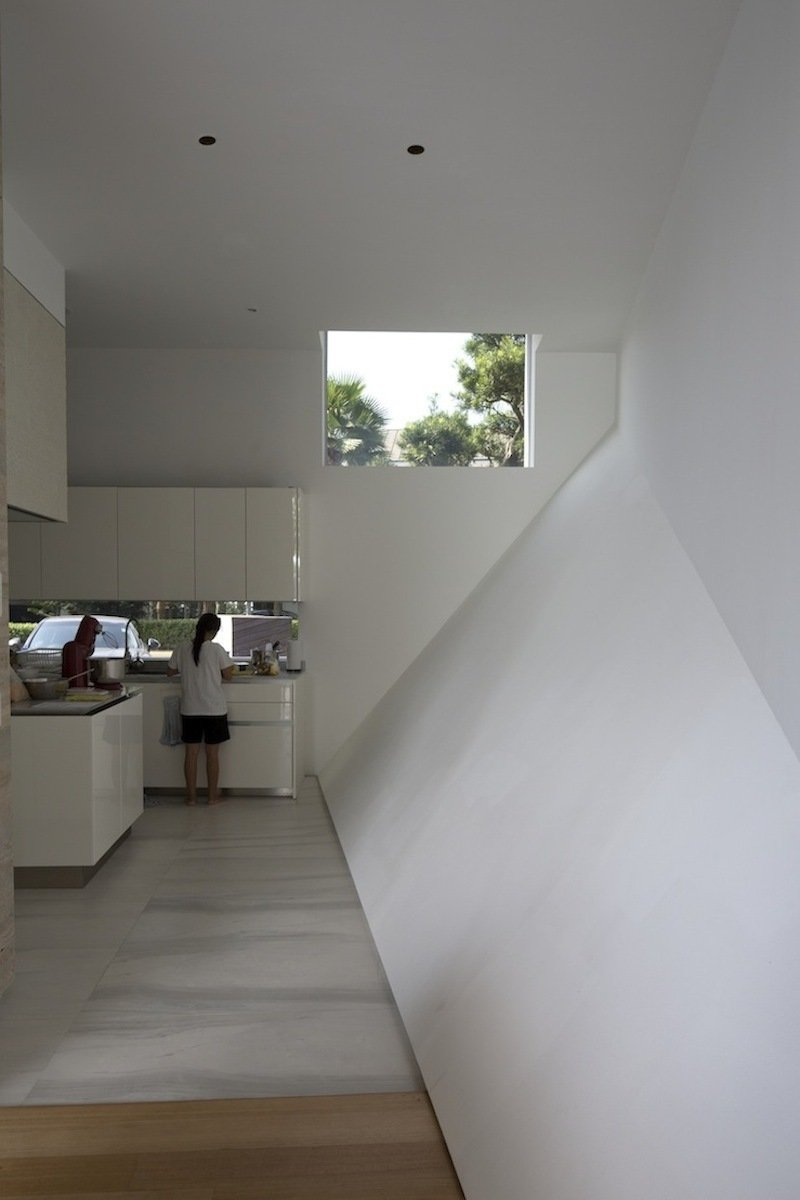White Kitchen, Lakeside Family Home in Singapore