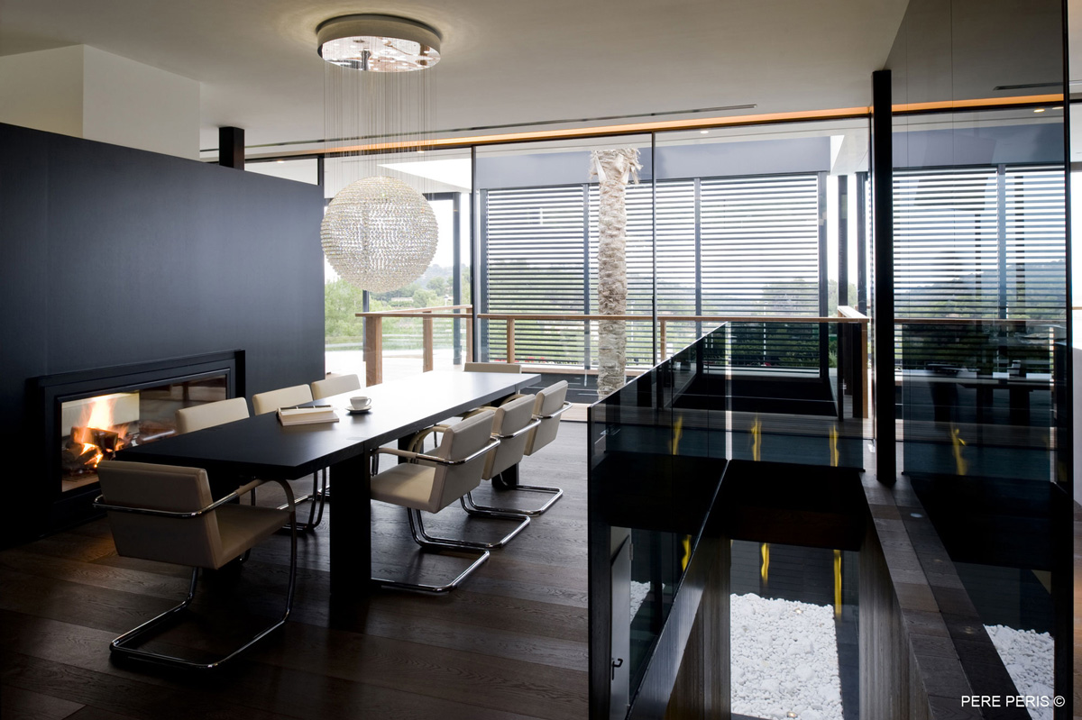 Contemporary Fireplace, Dining Table, Lighting, Stylish Glass Home in Valencia, Spain