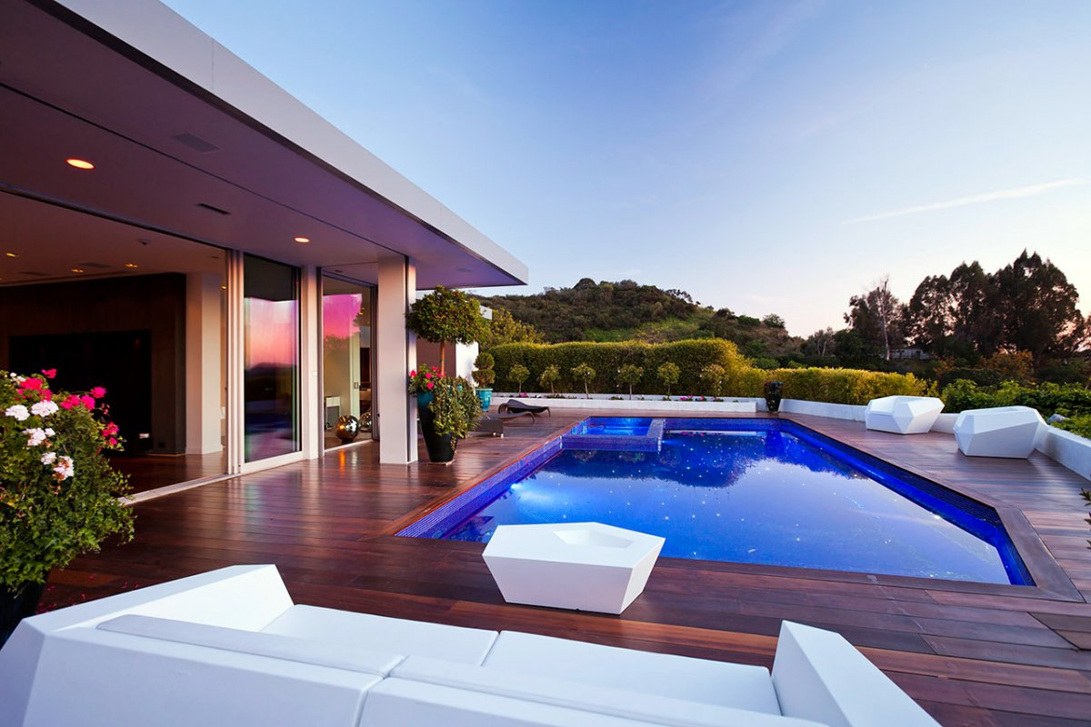 Dark Wood Deck, Pool, Outdoor Furniture, Renovation of a Hal Levitt Home in Beverly Hills