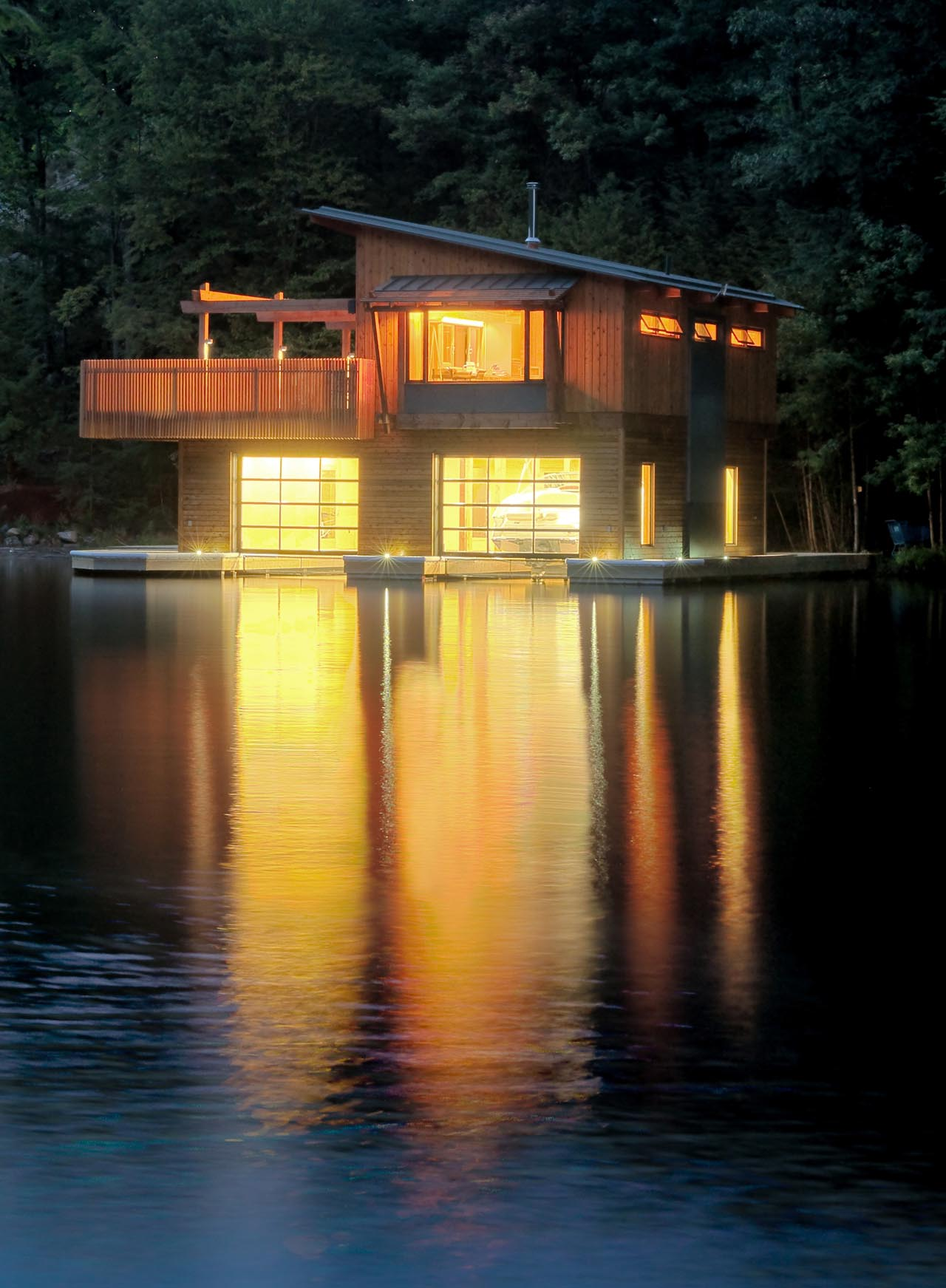 Evening, Lights Reflecting on the Water, Boathouse Renovation and Extension in Muskoka Lakes, Ontario