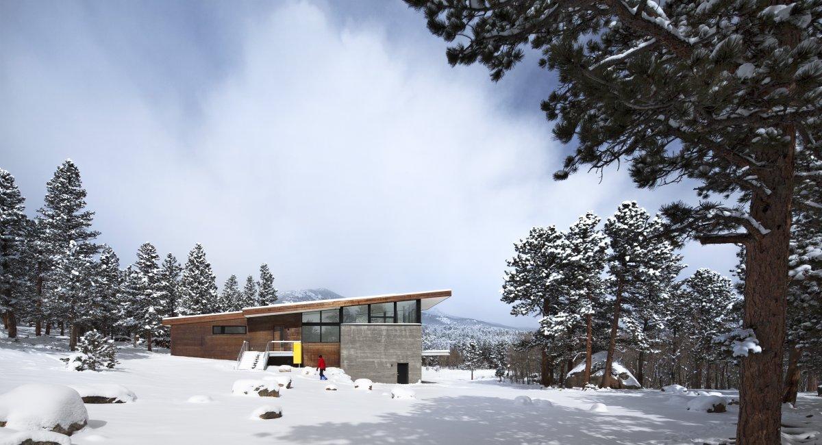 Side Facade, Entrance, Contemporary Cabin in the Rocky Mountains