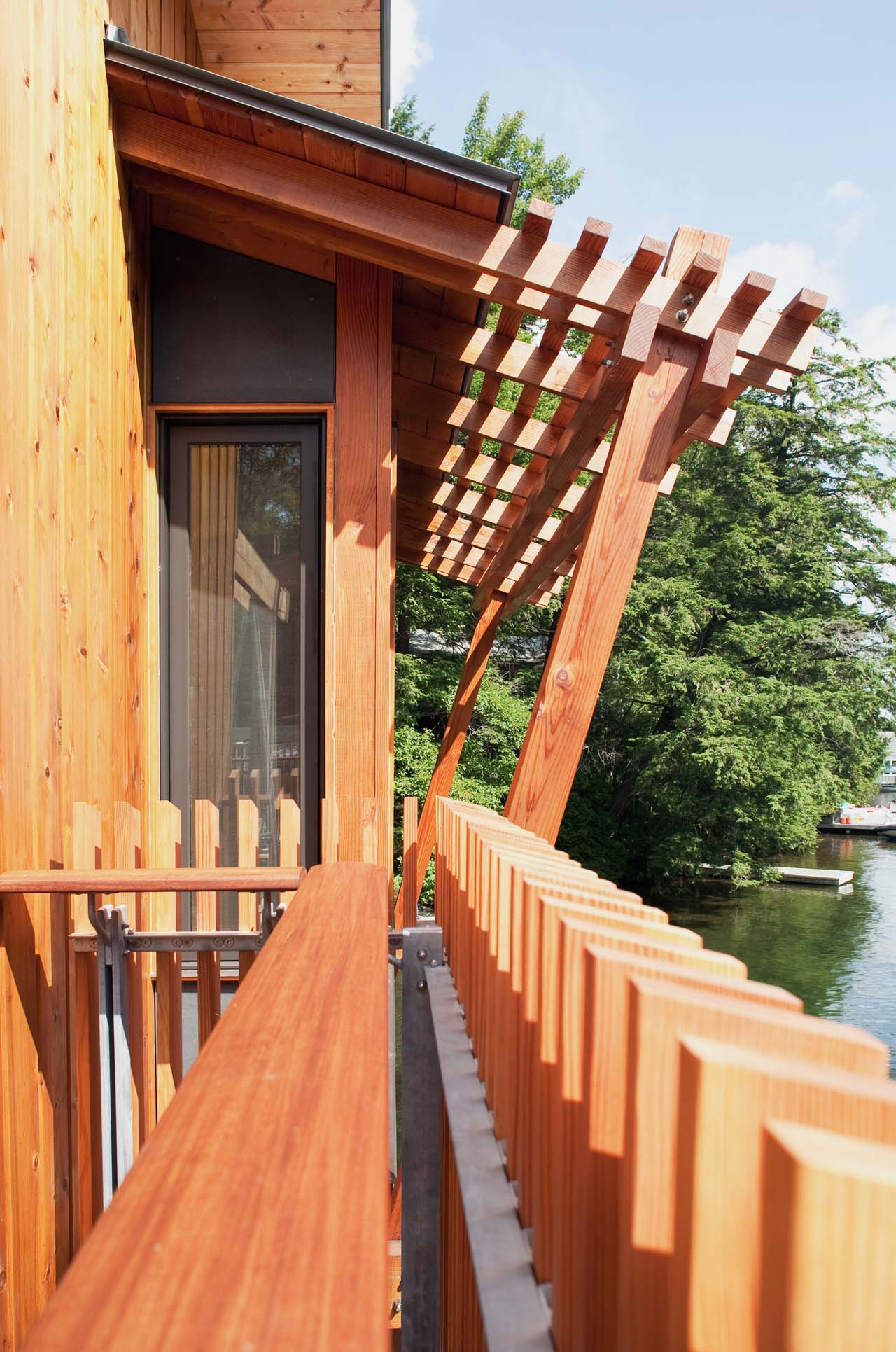 Wood Fence, Boathouse Renovation and Extension in Muskoka Lakes, Ontario