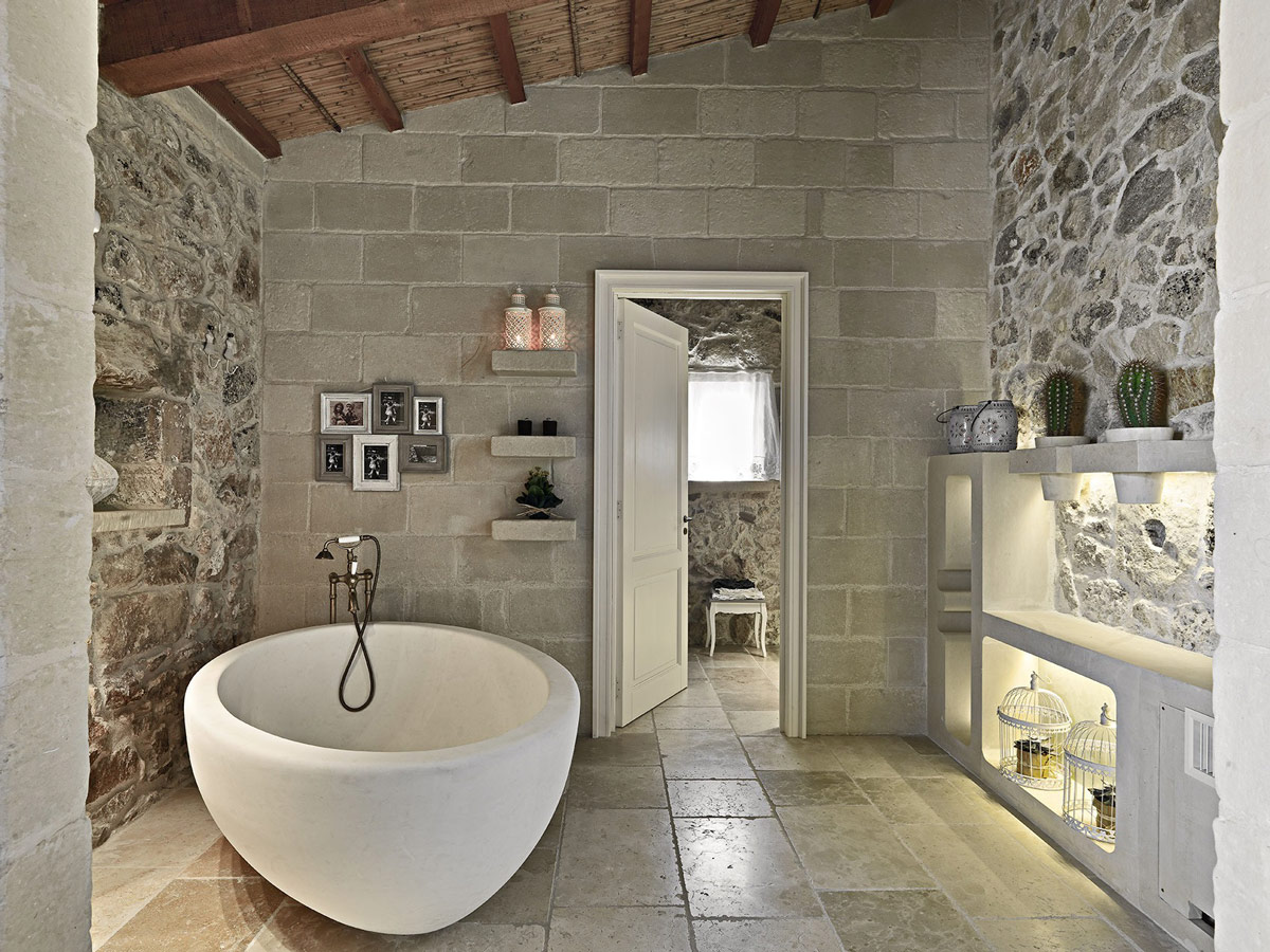 stone bathtub, tiles, relais masseria capasa hotel in martano, italy