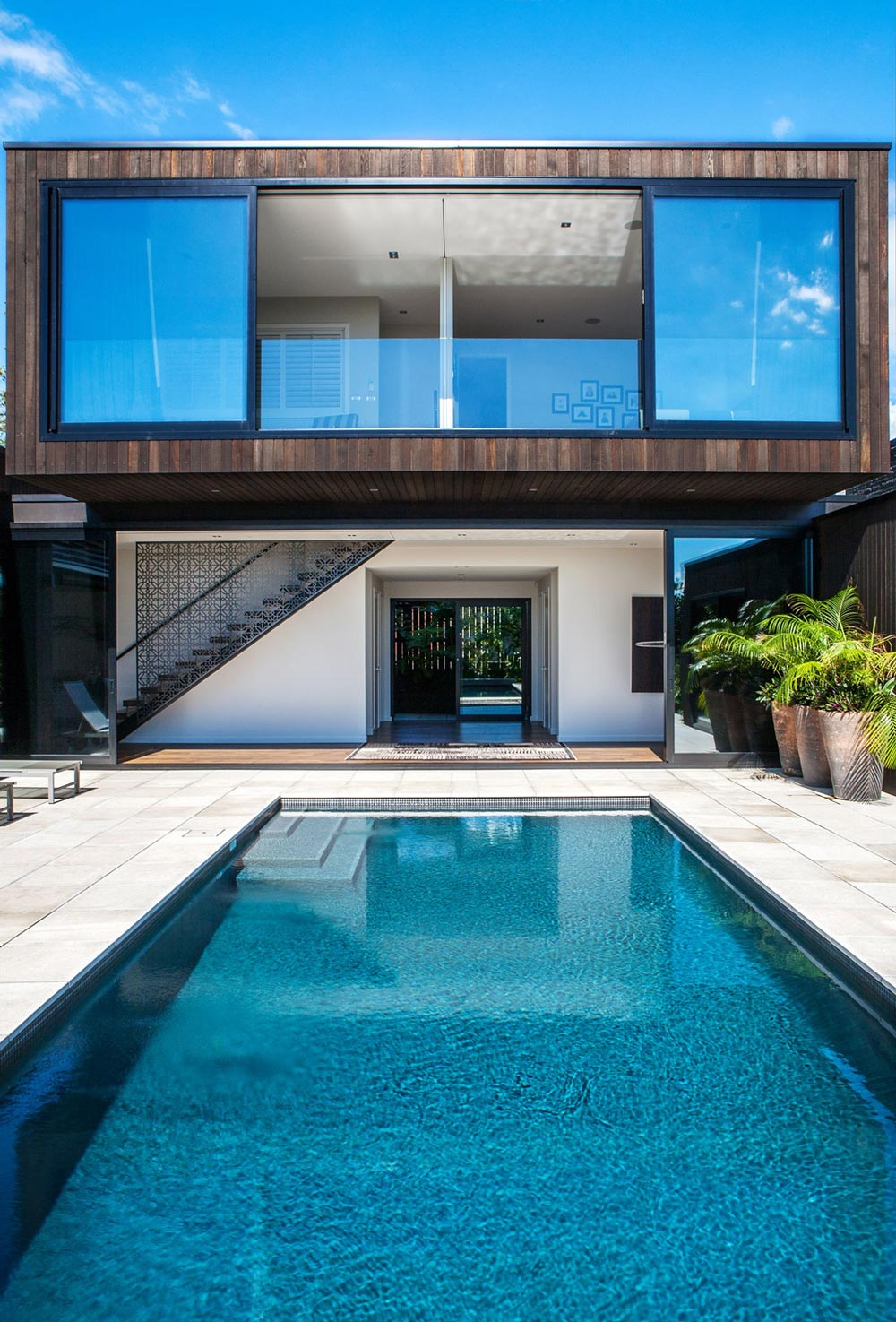 swimming pool terrace large windows modern house in