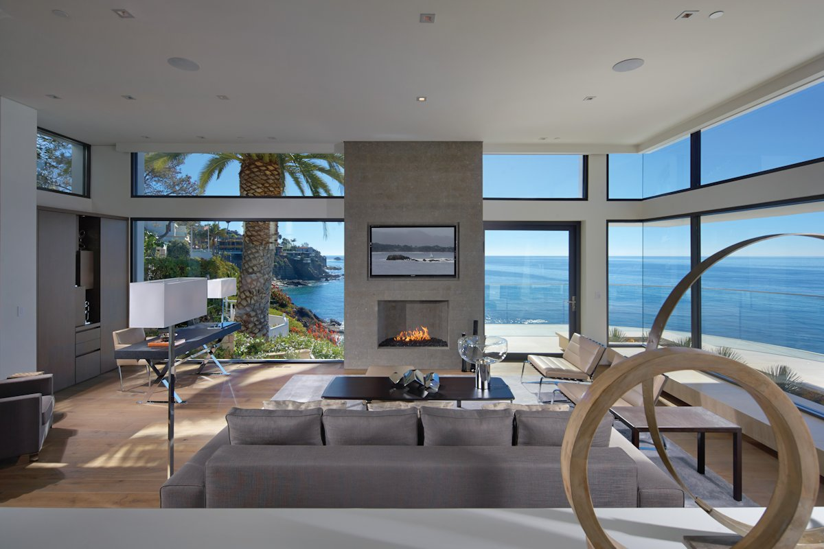Living room glass walls ocean views beach house in for Contemporary beach house interior design