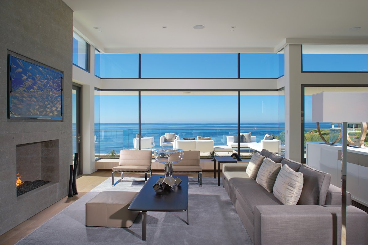 Sofa fireplace large windows beach house in laguna Modern houses with big windows