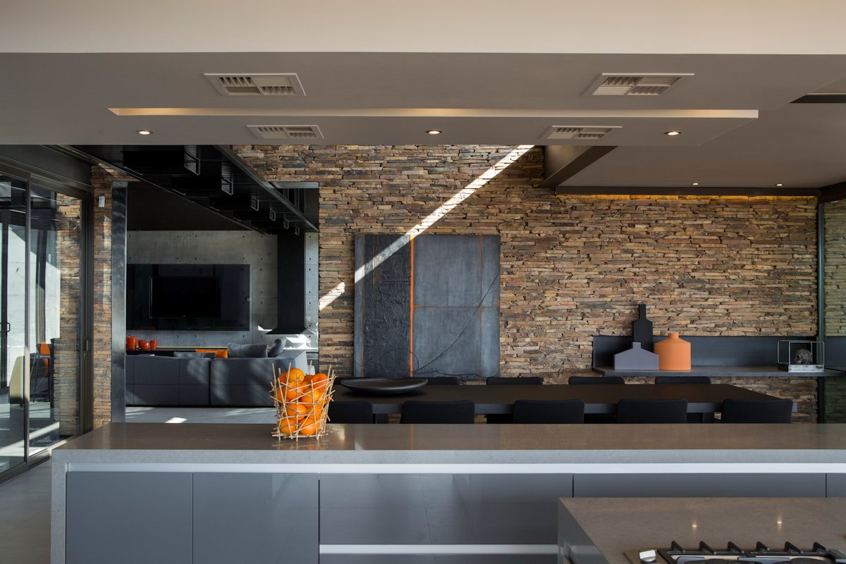 Contemporary Kitchen, Stone Wall, Dining Table, Luxurious Modern Residence in Pretoria, South Africa