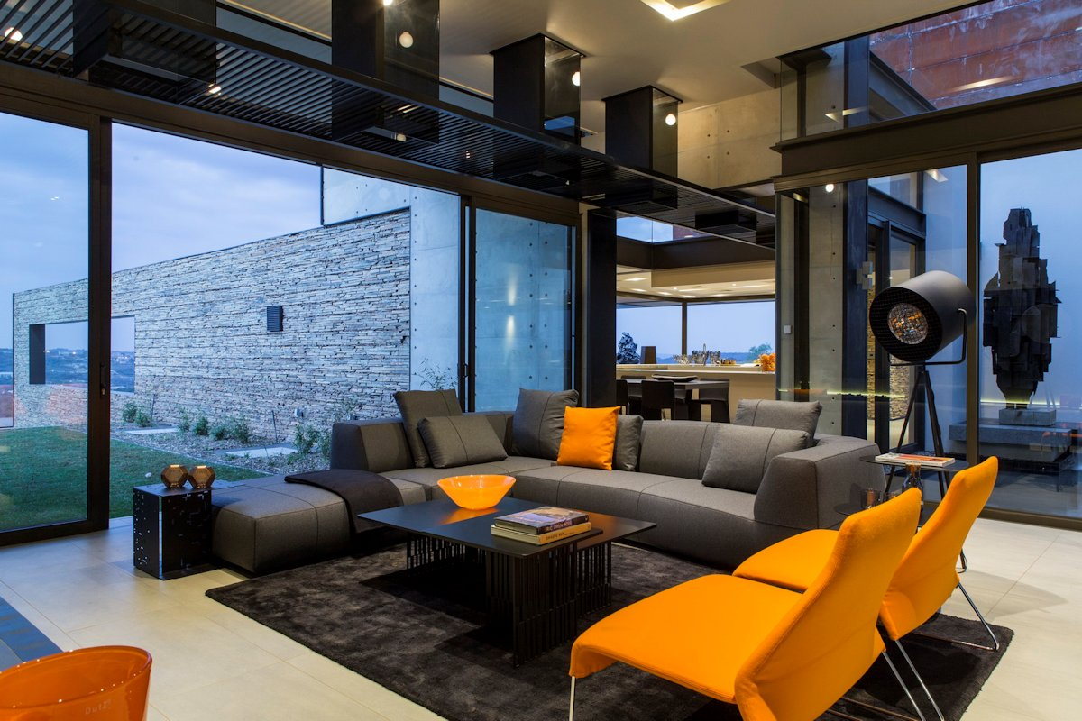 Grey Sofa, Orange Chairs, Rug, Coffee Table, Luxurious Modern Residence in Pretoria, South Africa
