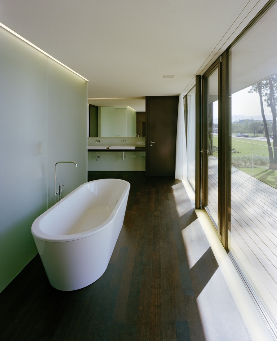 Bath, Dark Wood Flooring, Bathroom, Cantilevered House in the Town of Hard, Austria