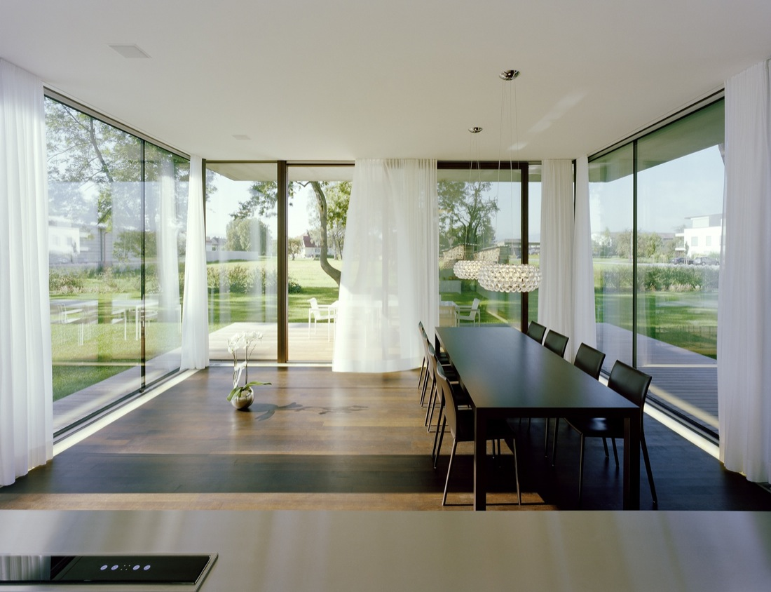 Dining Table, Lighting, Glass Sliding Doors, Cantilevered House in the Town of Hard, Austria