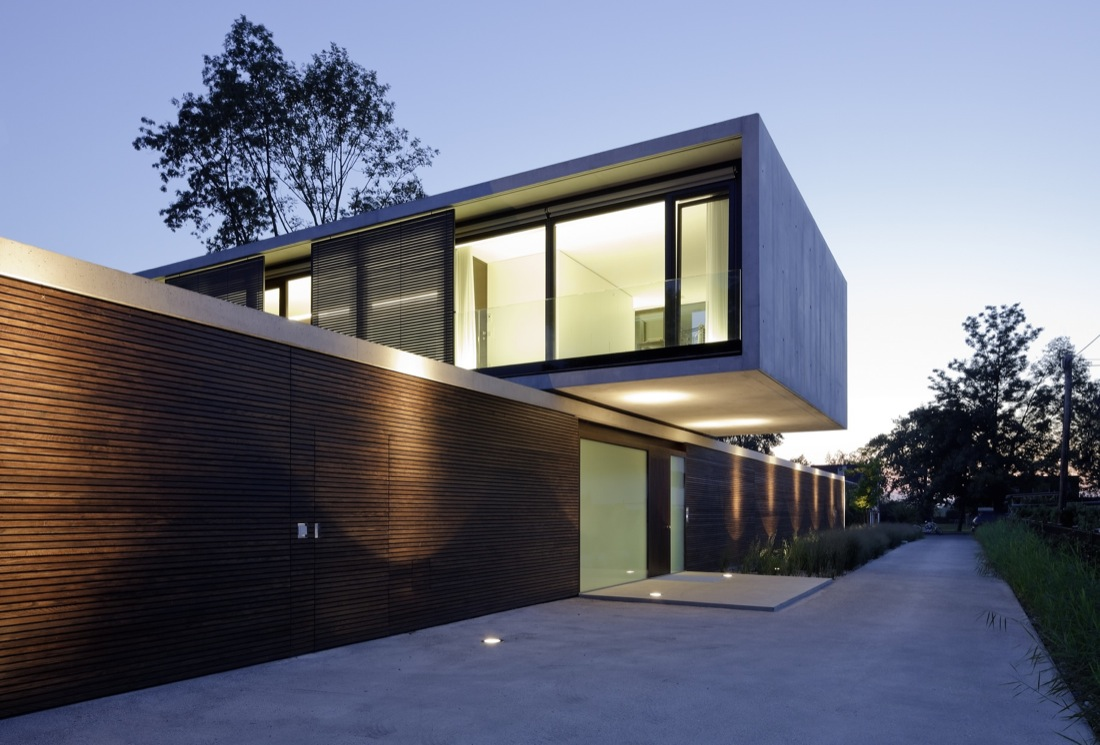 Entrance, Wood Cladding, Cantilevered House in the Town of Hard, Austria