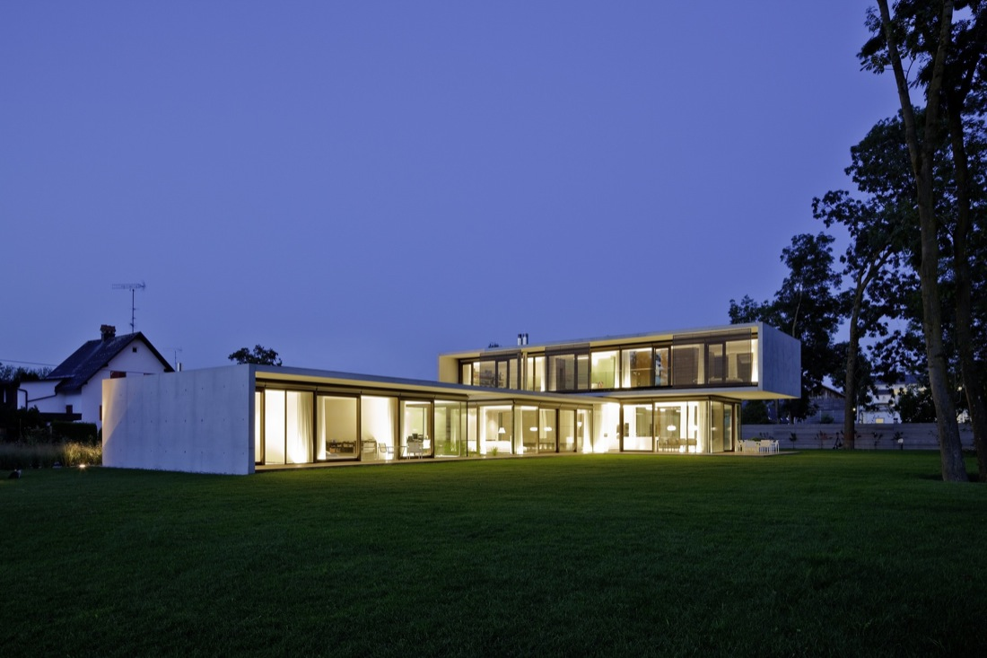 Evening Lighting, Cantilevered House in the Town of Hard, Austria