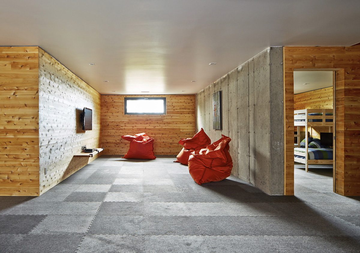Exposed Concrete Wall, Living Space, Malbaie VIII Residence in Charlevoix