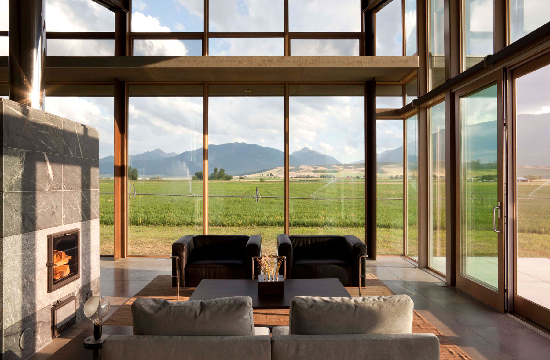 Fireplace, Seating, Rug, Living Space, Glass Walls, Glass Farmhouse in Northeast Oregon