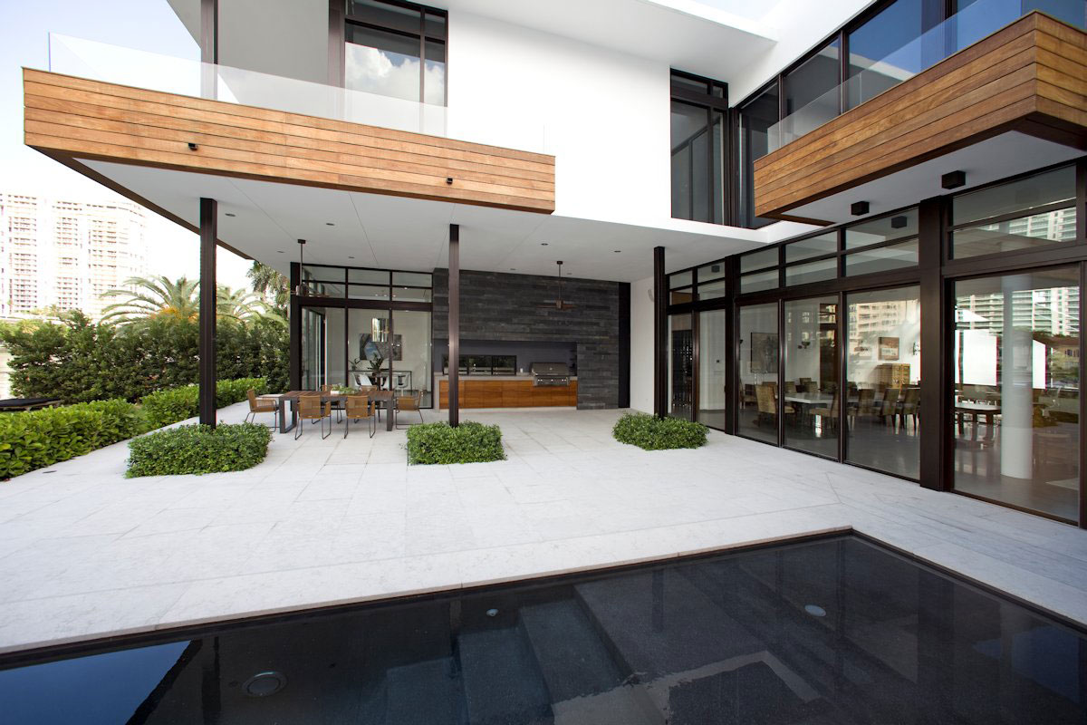 Terrace, Glass Sliding Doors, Modern Home in Golden Beach, Florida