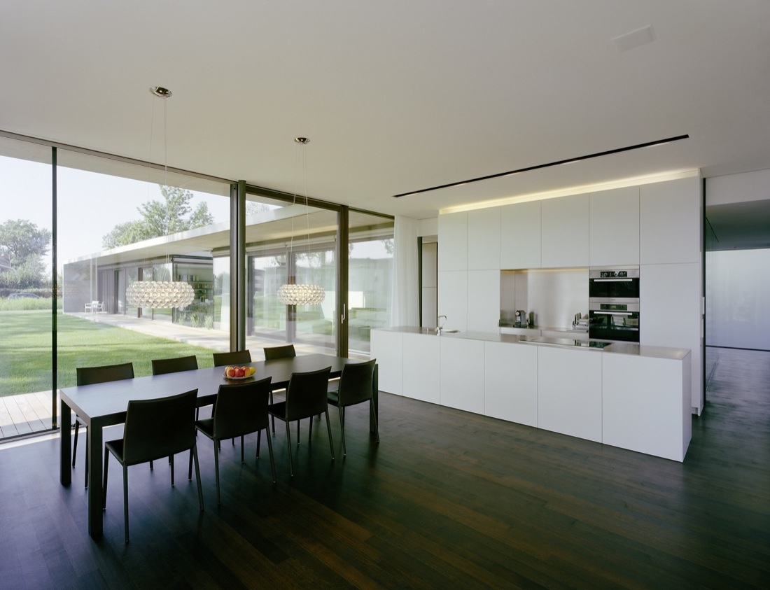 White Kitchen, Dark Wood Floor, Dining Table, Cantilevered House in the Town of Hard, Austria