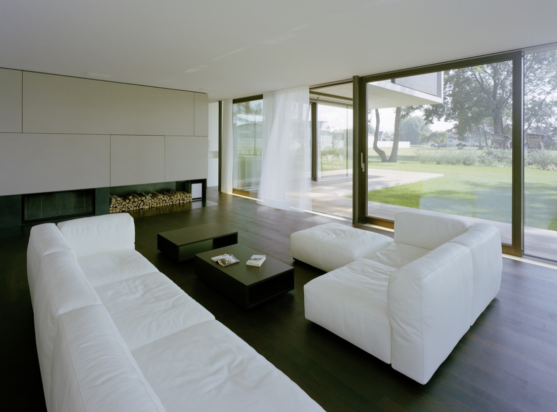 White Sofa, Wood Store, Fireplace, Cantilevered House in the Town of Hard, Austria